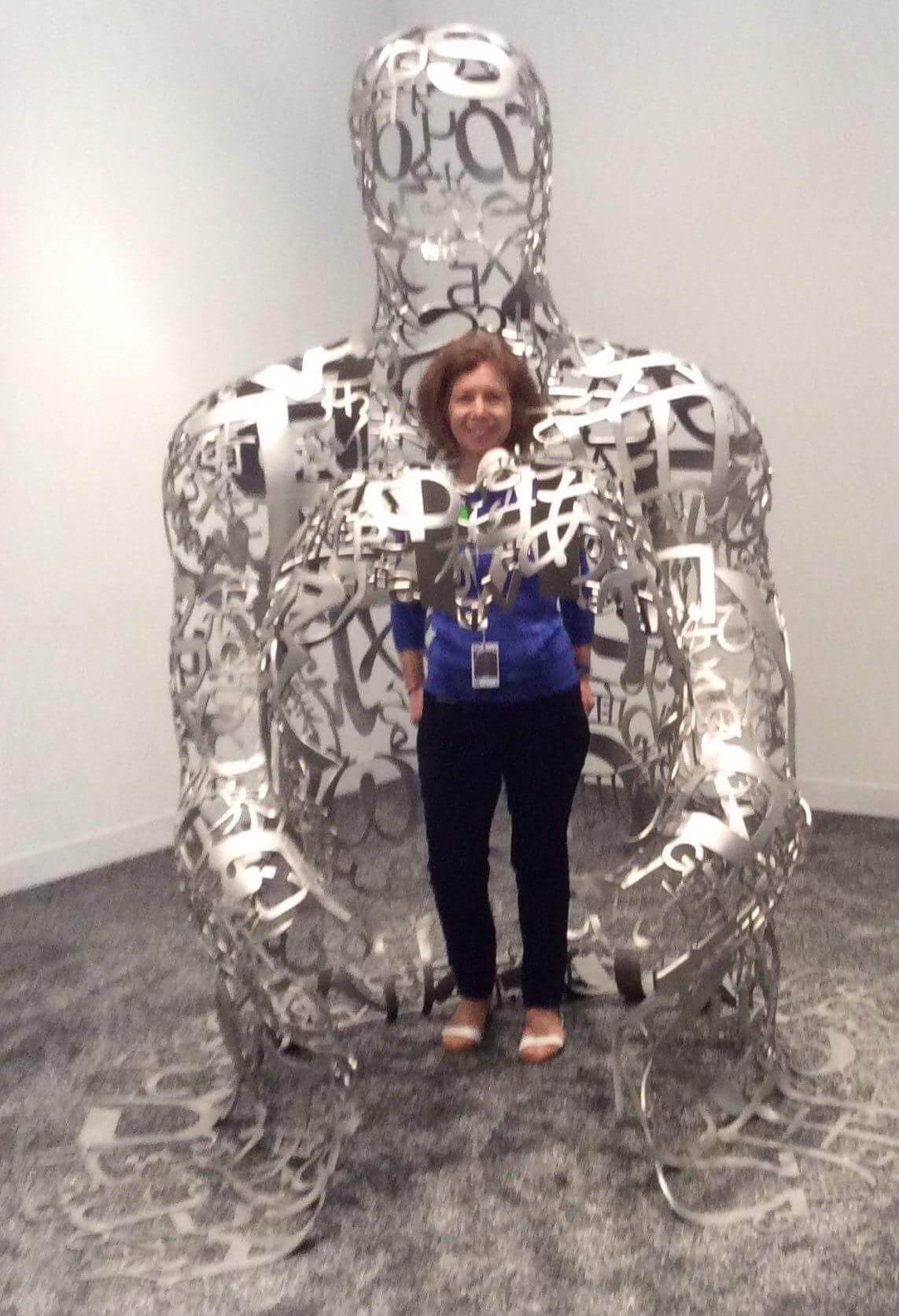Nancy Nesvet with Jaume Plensa's sculpture in the Collectors Lounge at Art Basel Miami Beach 2017.